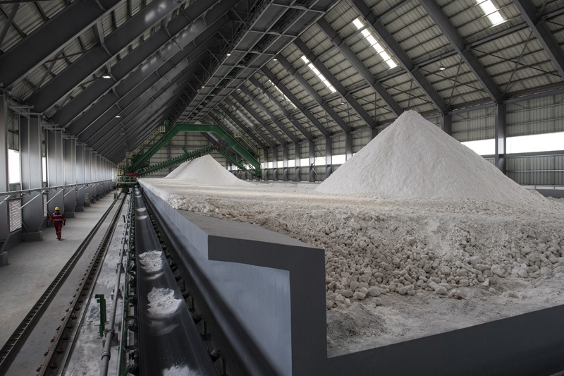 Salt deposits sit in huge piles inside a warehouse at a lithium production facility at the Salar de Uyuni, Bolivia